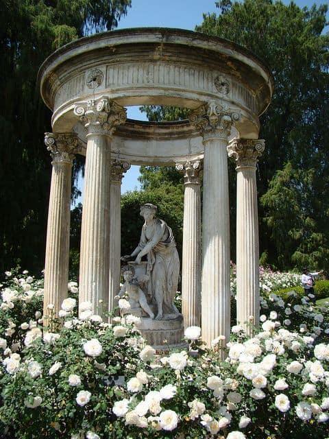 a stone gazebo in a blooming garden #gazeboideas #gazebo #pavillion #pavilion #backyardGazebo #flowers