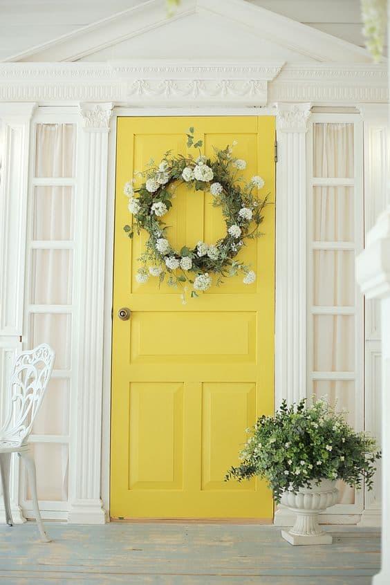 Easter Planter arrangement with a wreath on a porch #easter #backyardporch #porchIdeas #frontDoorDecor #frontDoorWreaths #frontDoorWreath