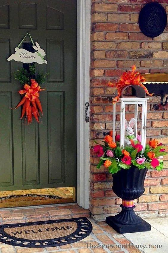 Easter Planter arrangement on a porch #easter #backyardporch #porchIdeas #frontDoorDecor #frontDoorWreaths #frontDoorWreath