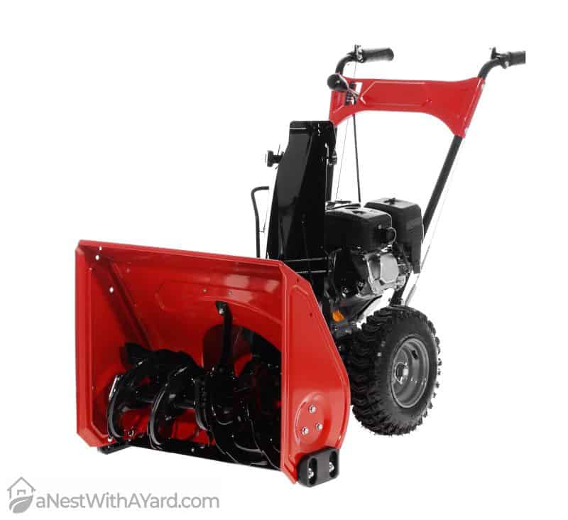 A red and black snow blower