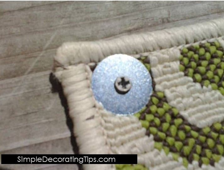 How To Keep Outdoor Rug From Blowing Away: fender washers and screws on a rug