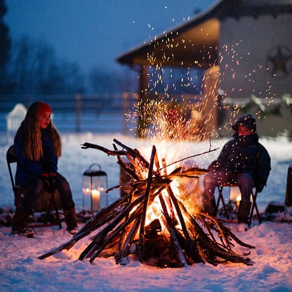 Outdoor winter party ideas: People around a bonfire