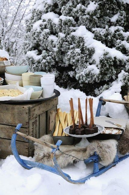 Outdoor winter party ideas: Outdoor Snack are set-up with snack tables, glasses, bowls
