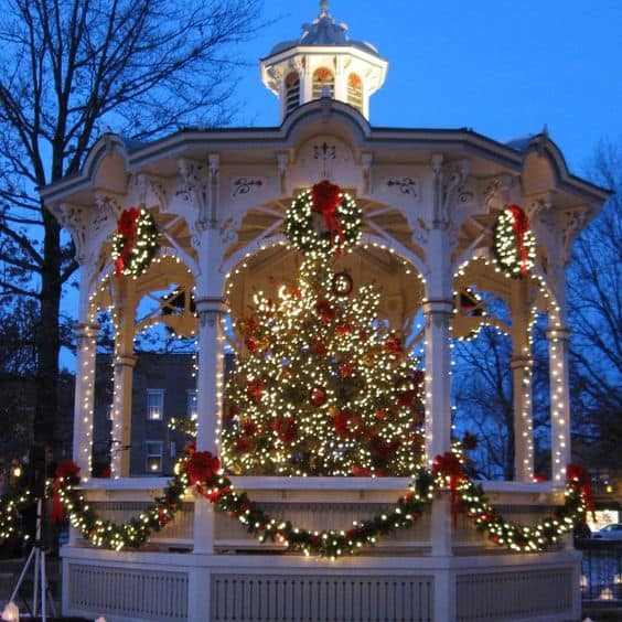 Outdoor winter party ideas: A gazebo illuminated at night and decorated for Christmas or New Year