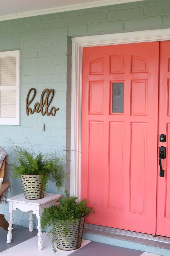 Curb appeal: Add a door sign next to your front door