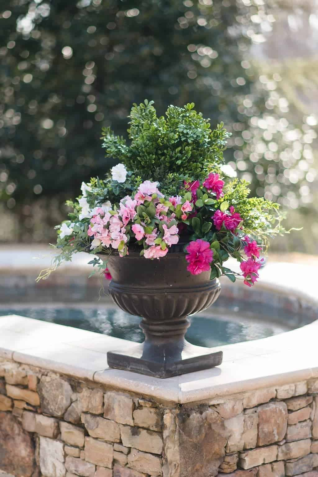 curb appeal tip - use fake flowers in outdoor decor