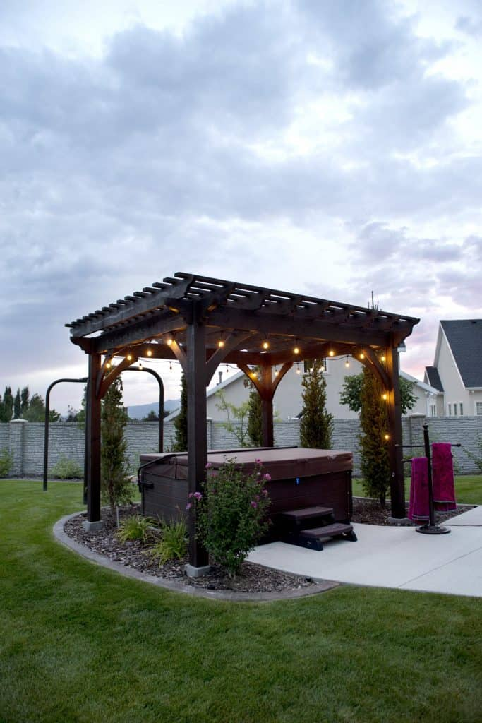 11 Backyard Pavilions Ideas You Didn't Know You Needed: Hot tob in a pergola