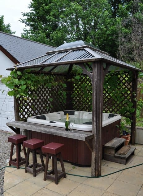 11 Backyard Pavilions Ideas You Didn't Know You Needed: Hot tob with a bar pavilion