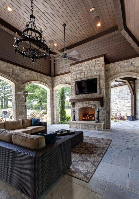 stone walls and beautiful wood-paneled ceilings on a pavilion