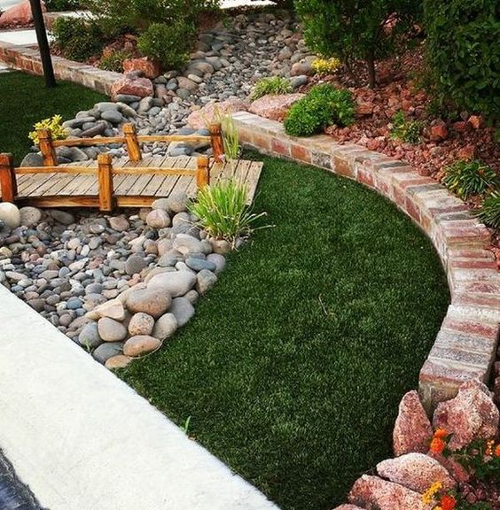 Dry river bed landscaping ideas: wooden bridge in your dry river bed