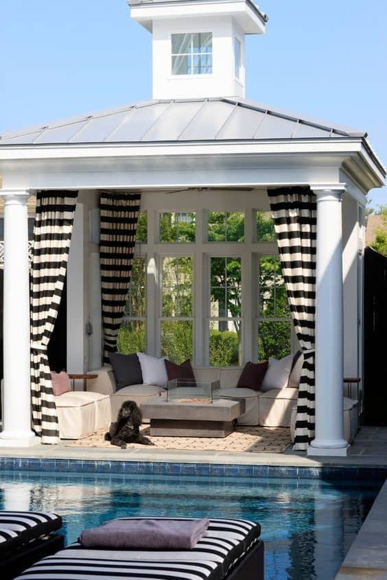 Gazebo near the pool with a glass back wall or drapes