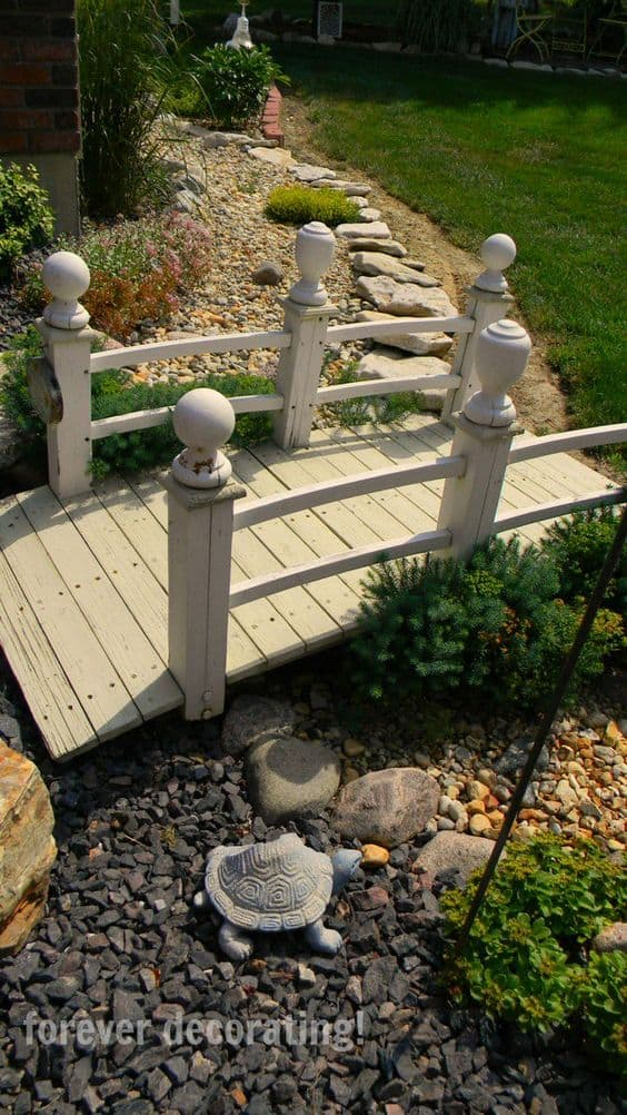 Dry river bed landscaping ideas:lassic white bridge