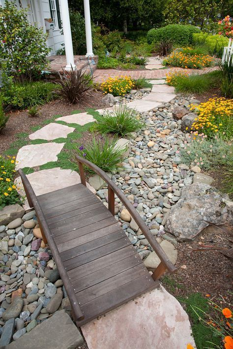 Dry river bed landscaping ideas: bridge, with curved side rail