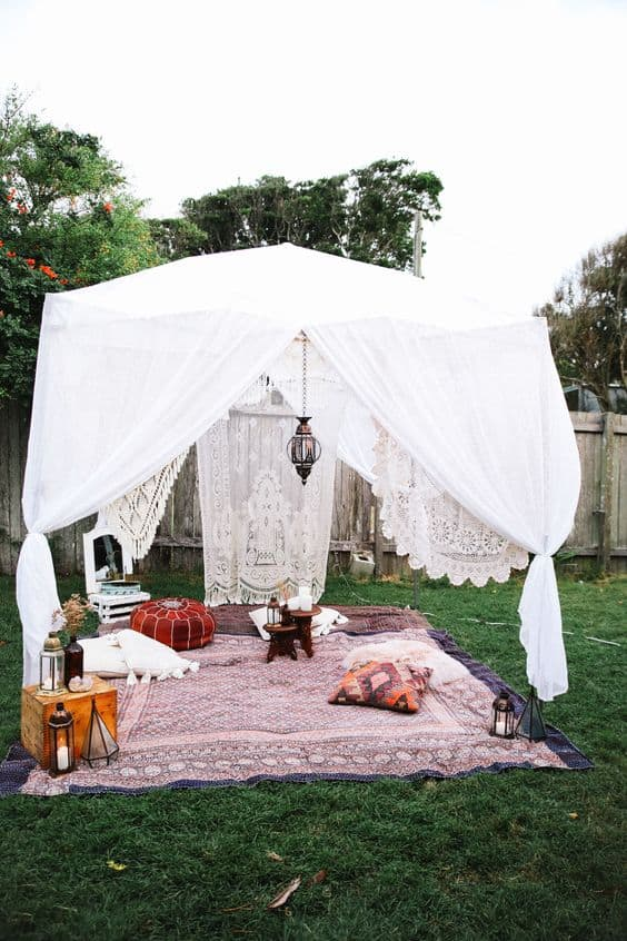 beautiful chiffon or lace curtains draped over a tent frame