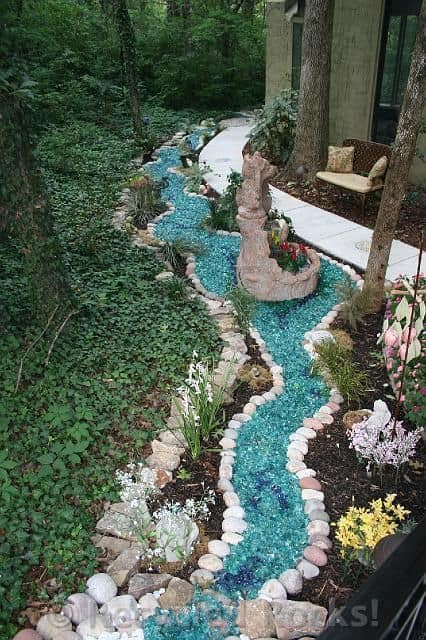 Dry river bed landscaping ideas:recycled colored glass pebbles