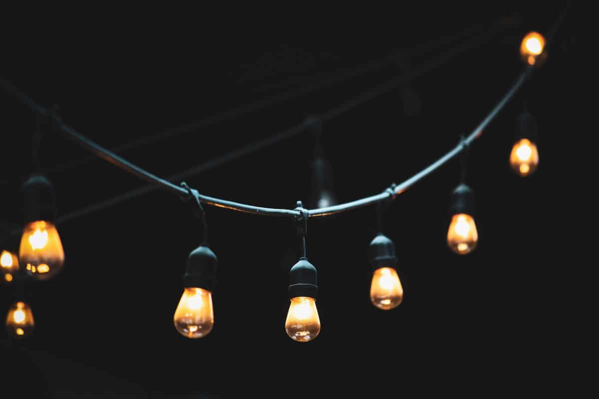 Step by Step Guide for Setting Up a Lighted Tent In Your Backyard: Hanging light bulb