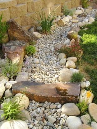 Dry river bed landscaping ideas:dry river bed bridge