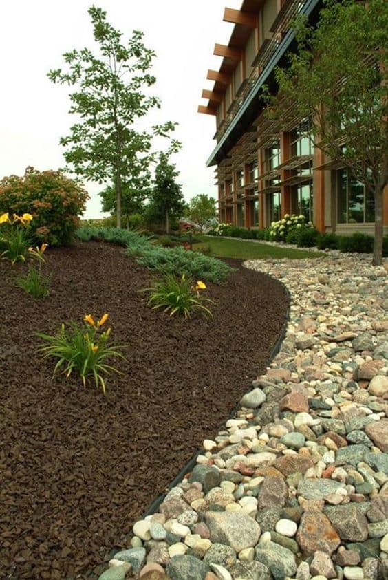 rocks create a border for the mulch planting area