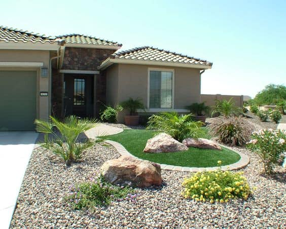 front yard landscaping, filling your garden ground with rocks and use bricks to separate it from the grass ground