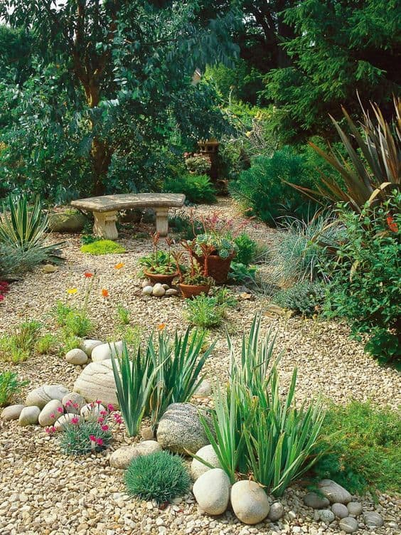 garden grounds filled with pebbles and accented with different sizes of rocks