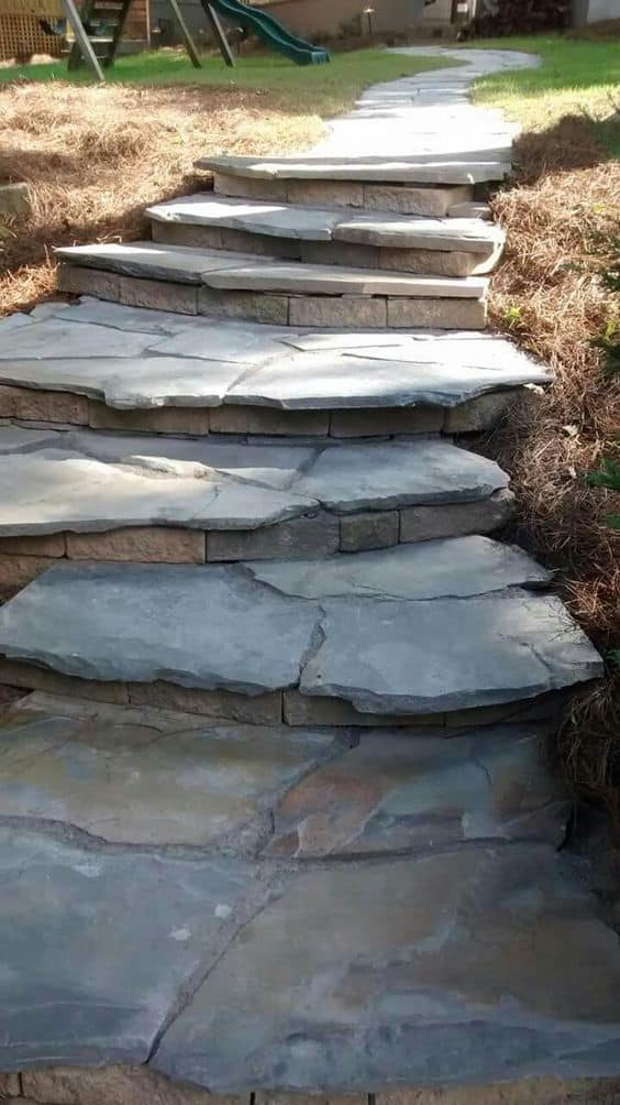 Stones on top of a clay brick for the walkway stairs  #walkway #Hardscaping #backyardLandscaping #backyardLandscapingIdeas #landscaping #cheapLandscapingIdeas #backyard #landscaping #curbAppeal #stairs