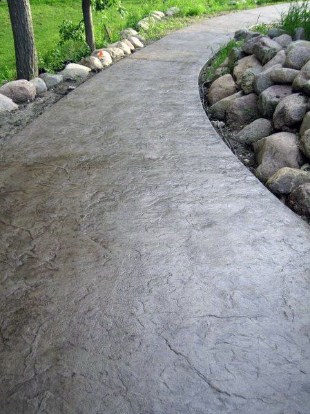 comcrete walkway with rocks lined up on the both side #walkway #Hardscaping #backyardLandscaping #backyardLandscapingIdeas #landscaping #cheapLandscapingIdeas #backyard #landscaping #curbAppeal #rocks