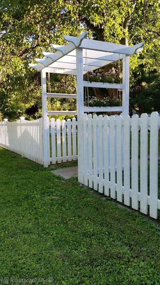 White picket with white arbor entrance