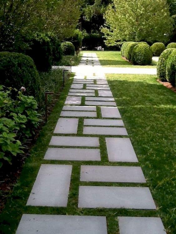 Tiles in unusual pattern and grass grows in between each tiles as a walkway  #steppingStones  #walkway #Hardscaping #backyardLandscaping #backyardLandscapingIdeas #landscaping #cheapLandscapingIdeas #backyard #landscaping #curbAppeal