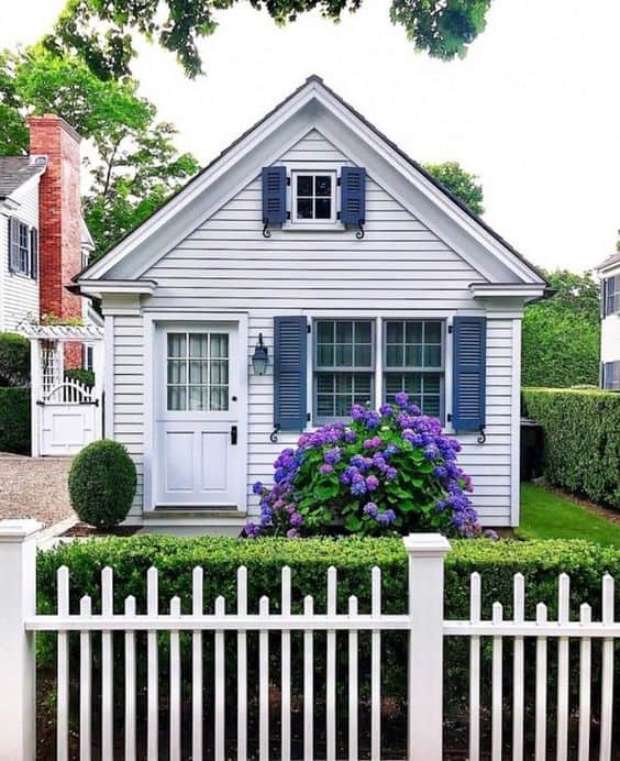 Asymmetric white picket fence for a bungalow house