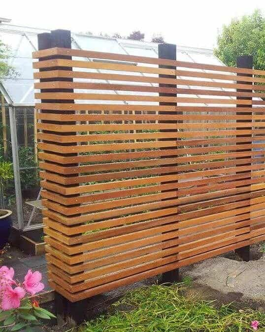 horizontal wooden fence sectioning 2 different areas