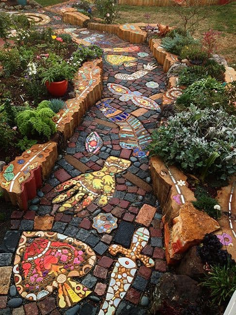 colorfull bricks, pavers, tiles, and stones as a walkway mosaic art  #walkway #Hardscaping #backyardLandscaping #backyardLandscapingIdeas #landscaping #cheapLandscapingIdeas #backyard #landscaping #curbAppeal #mosaic