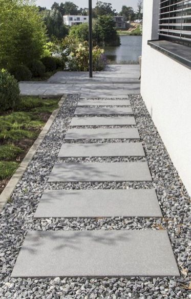 Uniform-shaped pavers on top of pebbles  #walkway #Hardscaping #backyardLandscaping #backyardLandscapingIdeas #landscaping #cheapLandscapingIdeas #backyard #landscaping #curbAppeal  #rocks  #steppingStones