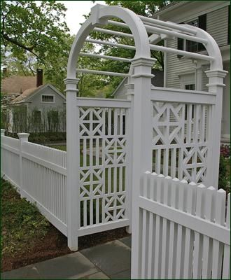 Elegant white picket with arbor entrance
