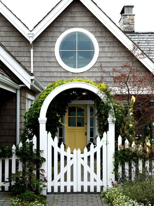 curved styled white picket with an archway arbor