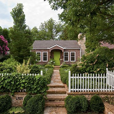 cottage with a thin picket fence