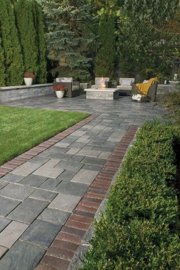 concrete interlocking pavers in different sizes for a cozy outdoor fireplace #walkway #Hardscaping #backyardLandscaping #backyardLandscapingIdeas #landscaping #cheapLandscapingIdeas #backyard #landscaping #curbAppeal #grass #firepit #outdoorSpace