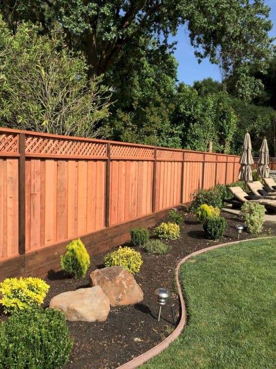 Lattice fencing with cross pattern on top and solid vertical pattern buttom