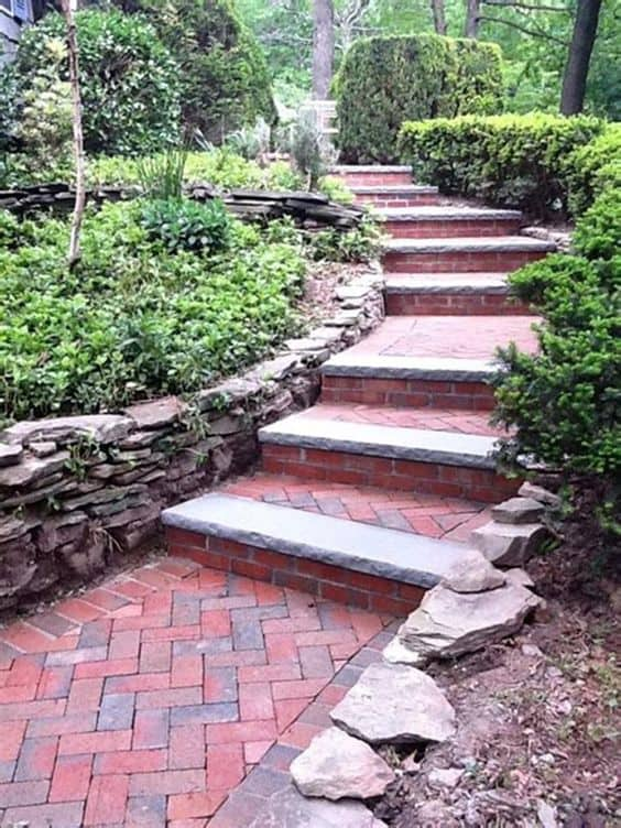 Interlocking concrete pavers for a walkway with stairs  #walkway #Hardscaping #backyardLandscaping #backyardLandscapingIdeas #landscaping #cheapLandscapingIdeas #backyard #landscaping #curbAppeal #stairs  #brickWalkway