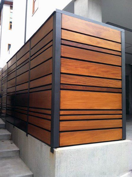 horizontal fence features asymmetrical wooden slats of different widths