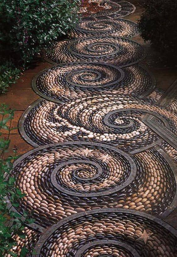 brown and black pebbles in a swirling design as a walkway   #walkway #Hardscaping #backyardLandscaping #backyardLandscapingIdeas #landscaping #cheapLandscapingIdeas #backyard #landscaping #curbAppeal #mosaic