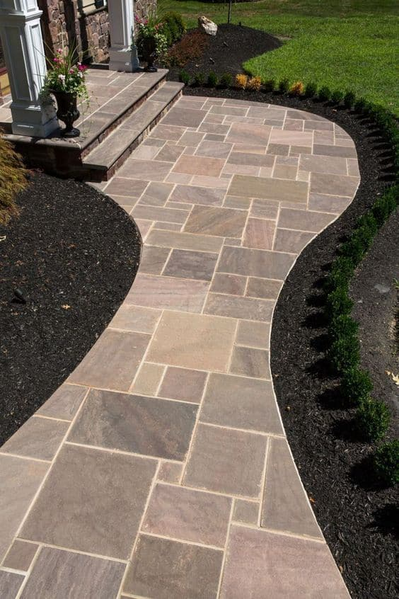 Curve pathway for a home front door, made of tiles #walkway #Hardscaping #backyardLandscaping #backyardLandscapingIdeas #landscaping #cheapLandscapingIdeas #backyard #landscaping #curbAppeal  #brickWalkway