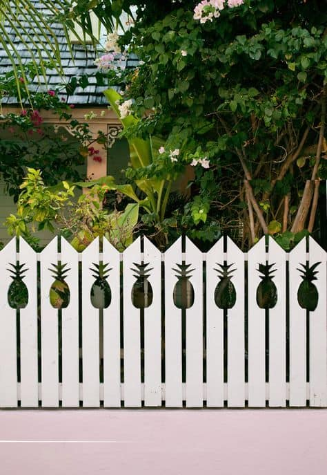 wooden white picket fence with pineapple design