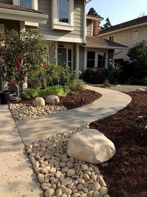 Beige concrete front yard pathway   #walkway #Hardscaping #backyardLandscaping #backyardLandscapingIdeas #landscaping #cheapLandscapingIdeas #backyard #landscaping #curbAppeal #rocks
