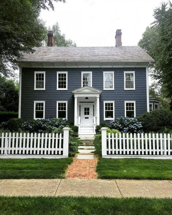 White picket fence for a grey house