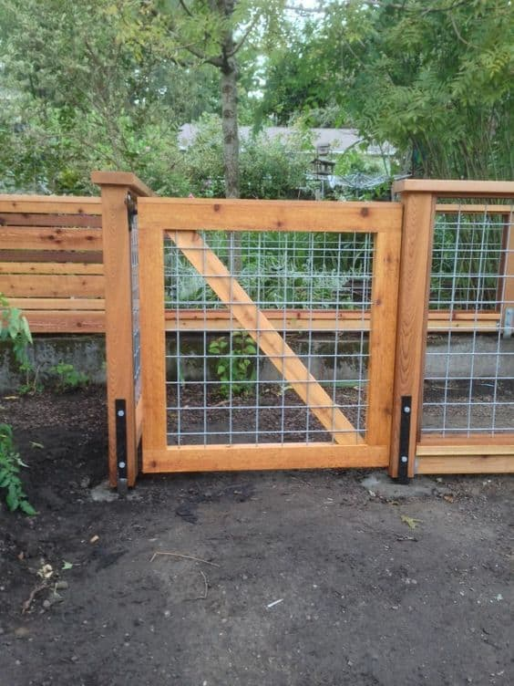 ire grid panel inside the wooden frame of your gate #fenceGate #fence #gardenfence #gardenfenceideas #privacyfenceideas #privacyfence #backyardLandscaping #backyardLandscapingIdeas #landscaping #gardenfence #gardenfenceideas #privacyfenceideas