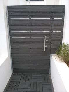 paneled black gate matching the black floor#fenceGate #fence #gardenfence #gardenfenceideas #privacyfenceideas #privacyfence #backyardLandscaping #backyardLandscapingIdeas #landscaping #gardenfence #gardenfenceideas #privacyfenceideas