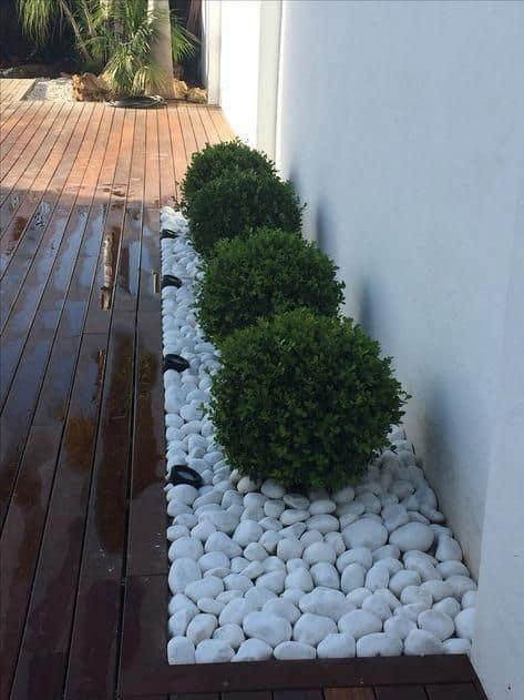 minimalist corner landscaping design with white rocks  #flowers #garden #flowerbeds #Hardscaping #mulch #rocks #backyardLandscaping #backyardLandscapingIdeas #landscaping #cheapLandscapingIdeas #backyard #landscaping #curbAppeal