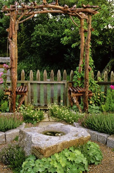 garden arbor made of logs with benches on both sides #arbor #backyardLandscaping #backyardLandscapingIdeas #landscaping #cheapLandscapingIdeas