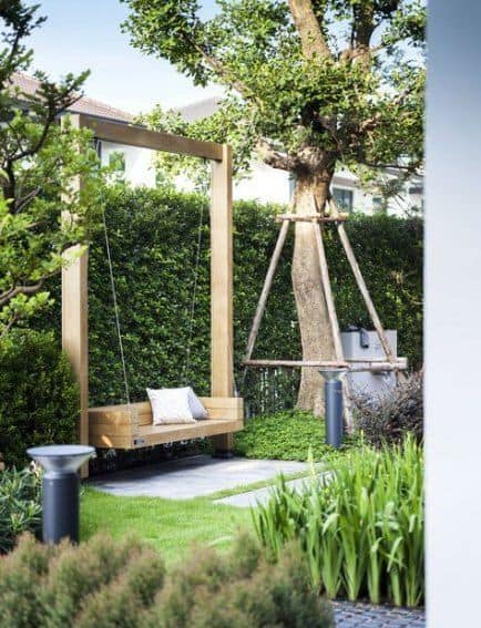 outdoor wooden swing  #outdoorSpace #outdoorFurniture #swing #backyardFurniture #backyardLandscaping #backyardLandscapingIdeas #landscaping #cheapLandscapingIdeas #backyard #landscaping #curbAppeal