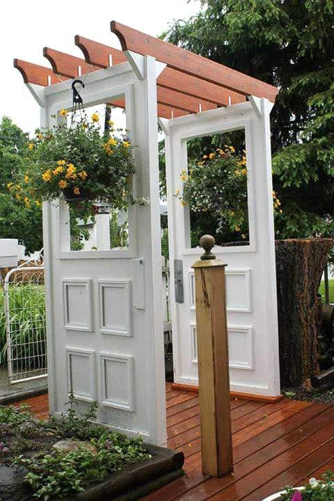 recycled door arbor with two hanging pot plant #flowers  #arbor #backyardLandscaping #backyardLandscapingIdeas #landscaping #cheapLandscapingIdeas #backyard #landscaping #pergola